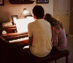 Will and Lin playing piano