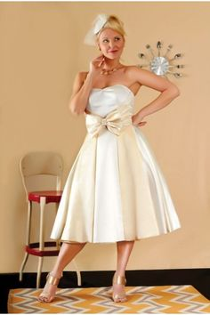 """The Brandis 1950s inspired two toned short wedding dress - was $695 NOW $395 Only 1 left in Size 18 at your big day bridal salon try before you buy or to order - 818.900.0923 ABOUT: Inspired by the 50's this gown is the cutest, sweetest wedding dress for the most darling brides! CONDITION: good SIZE/COLOR: 18 - bust 46"""" / waist 40"""" in champagne & ivory SHIPPING: $45  CONTACT: sales@dollycouture.com"""