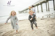 La Jolla Family photography at the Scripps Pier was photographed by Holly Ireland Photography. Sunset beach family photos in San Diego Ca.
