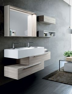 Exciting geometric stepped design from LASA Idea's Syn bathroom furniture range. White Matt washbasin paired with Olmo Rock furniture. Bathroom Cost, Bathroom Storage, Small Bathroom, Bathroom Designs, Italian Bathroom, Wall Hung Toilet, Concrete Bathroom, Wall Mounted Vanity, Vanity Units