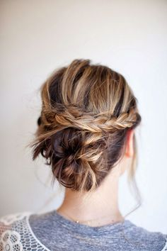 Low, messy bun with braid detail. #hairstyle #braid #updo