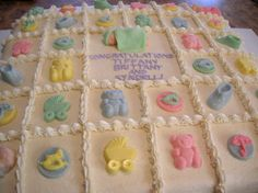 Close up of my16x16 sheet cake for a triple baby shower! All buttercream, with hand made candy clay babe, and white chocolate candy decorations! All edible!  http://www.facebook.com/angelas.cakes2011