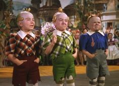 Munchkins:  In the 1939 film The Wizard of Oz, they are played by adult proportional dwarfs, dressed in brightly multicolored outfits, and live in Munchkinland