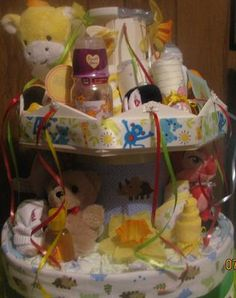 I love this carousel diaper cake sent in by Patricia, what a fun and unique twist on the diaper cake! This would be perfect for a circus or carnival themed Diy Diapers, Baby Shower Diapers, Baby Shower Fun, Baby Shower Gifts, Baby Gifts, Baby Showers, Unique Diaper Cakes, Nappy Cakes, Candy Boquets