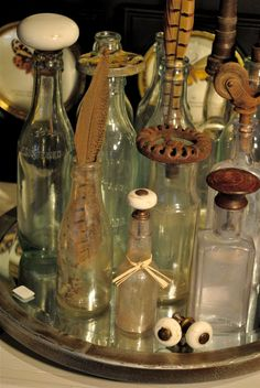 Curious Bottles @ Bountiful Home and Nursery.in Edmonds WA (Decorated Bottle Upcycle) Old Glass Bottles, Glass Bottle Crafts, Antique Bottles, Vintage Bottles, Bottles And Jars, Bottle Art, Vintage Perfume, Antique Glass, Perfume Bottles