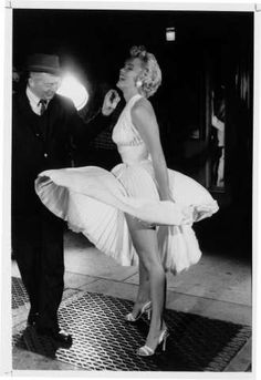 """Film director Billy Wilder watches as actress Marilyn Monroe stands on a subway grate on the set of Wilder's film """"The Seven Year Itch"""" in New York City in 1955.  Photo: GEORGE ZIMBEL, Unknown / Handout"""