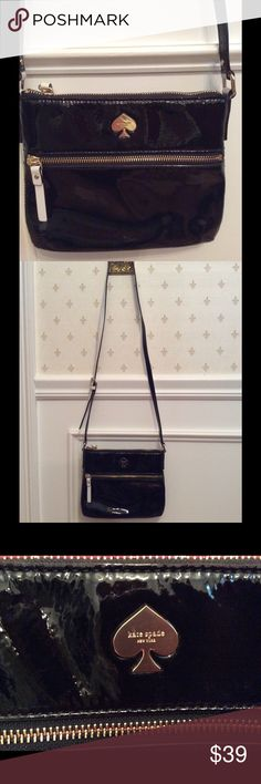 "Kate Spade black patent leather cross body bag Gorgeous Kate Spade cross body bag.  Black patent leather with white leather trim.  Ace of spades logo in gold.  Zippered top & front    Tan inside lining with pocket.  Includes Kate Spade dust bag.  Adjustable strap 20"" drop   No marks inside or out.  Free of smells. kate spade Bags Crossbody Bags"