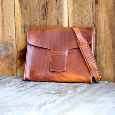 """English-tan Dublin leather from the Horween Tannery in Chicago. A smaller messenger bag, perfect for a 13"""" laptop."""