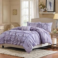 Add a bold pop of color to your bedroom with the Harlow comforter set. Harlow is a fun purple comforter set pieced together with ruching and embroidered details. The center of the comforter features a pieced look and the sides are ruched to create a variety of texture and dimension. The comforter set includes two king shams and three embroidered decorative pillows in purple and white that adds color and detail to this collection.