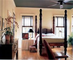 Neat room setting and paint scheme using an American empire tall post bed and a sideboard used as a bedroom case.