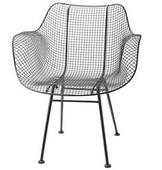 Rejuvenation has imported version of old Woodard chair in dark brown or silver for $299.  This would look/work great with sheepskin.
