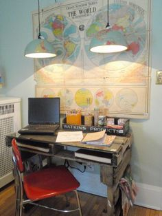 The desk is cool, but cramped even if the use of the palettes' structure for storage is smart. Check out those drop down globe lamps though! They remind me of lights I loved at Starbucks over their high workspace table, and would be hella cheap.