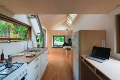 Marjolein's tiny house has cutting edge, almost futuristic styling, with unusual angles and lots of large windows, but it still looks right at home in a forest clearing filled with . Read moreTrue off-grid living in a stylish Dutch tiny house Off Grid Tiny House, Tiny House Blog, Modern Tiny House, Tiny House Design, Tiny House On Wheels, Casa Loft, Loft House, House Built, Tiny House Movement