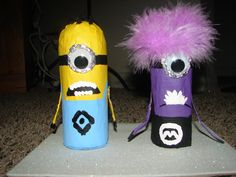 Paper Mache Minions made from toliet paper rolls and newpapers. My son Nathan and I made this for his 4-H project.