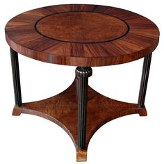 An Unusual Swedish Art Deco Rosewood and Amboyna Veneered Circular Center Table   From a unique collection of antique and modern center tables at http://www.1stdibs.com/furniture/tables/center-tables/