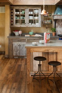 """Rustic Materials - Dream Kitchen: Family Friendly Style - Southernliving. """"The old wormy chestnut barn siding is really a soft, beautiful touch,"""" says Bee, """"And I'm so glad we chose to do our walls in plaster. It really adds warmth, texture, and depth.""""    Love It? Get It!Cabinetry: Custom, Billy Micus, Gordonsville, VA"""