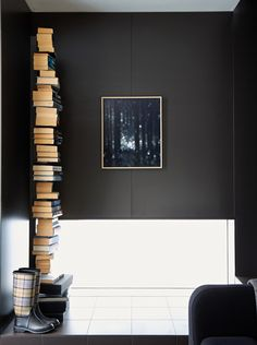 Entrance.  Gumboots by Barbour, Ptolomeo book shelf.  Photo - Sean Fennessy, Production – Lucy Feagins / The Design Files.