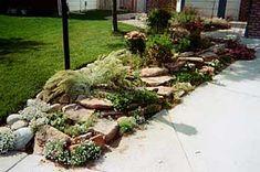 Rock garden along driveway