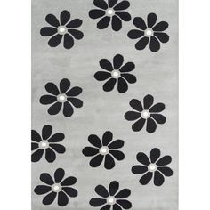 This Alliyah floral rug in ash grey-colored New Zealand blended wool is hand-washed and hand-carved for optimal luxury. Bold flowers in black and off create a modernly organic style for this gorgeous rug.