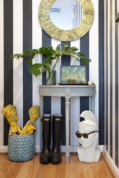 30 Inviting Entryways by Apartment Therapy. Messagenote.com Solar mirror, stripy walls in black and white, beautiful umbrella storage, funny glass organiser, semi-console, palm leaves, small art and a shell