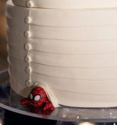 CUTE IDEA ALERT! At the bottom of the Wedding cake, hide a little something for the groom... like a sports mascot, band logo, mini superhero, anything! #WeddingCake #GroomCake #Grooms