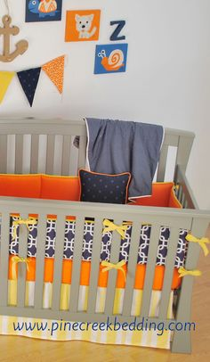 Navy Orange Yellow nautical crib bedding. Banner made by Back at the Pond Designs.