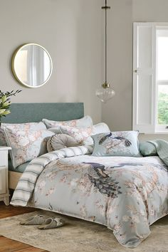 Classically ornate, the Belvedere print features elegant peacocks and timeless florals, and is the perfect addition to luxurious spaces. Belvedere is made from 220 thread count cotton sateen, and finished with a piped edge. This Laura Ashley bedset is reversible so that you can style it two ways and comes complete with matching pillowcases. Additional pillowcases are available to buy separately.