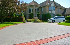 Your driveway can look as classy and presentable as this with the help of Sundek Classic Texture! We offer a variety of concrete driveway resurfacing designs just for you! Call (323) 319-5230 now and we'll give you more information as well as a FREE quote!