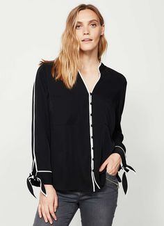 Simple, yet chic, is this black shirt, with tipped contrast hems and delicate bows on the sleeves. Model is 5'10in and wears a size 10. The length from side neck point to front hem measures 69cm/27in.