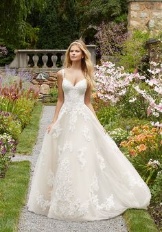 Styled in tulle adorned with frosted Alencon lace appliques, this Mori Lee Bridal 2020 Paoletta strapless bridal ball gown showcases a sweetheart neckline. Applique shoulder straps lead into the semi-open illusion back, accented with covered … Mori Lee Bridal, Mori Lee Wedding Dress, Western Wedding Dresses, Bridal Wedding Dresses, Wedding Dress Styles, Dream Wedding Dresses, Lace Wedding Dress Ballgown, Fall Wedding Gowns, Wedding Dresses With Straps