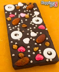 Sharanya creates happiness bars with us all the time. Here is her latest dark chocolate creation with peppermints, lime n chilli almonds, hearts, silver sugar dots and butterscotch!
