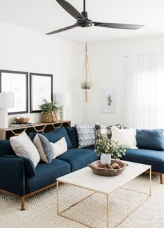 modern boho living room decor with blue velvet sofa and gold coffee table, navy sofa and boho pillows in living room design decoration Step Inside an Austin Home That Pairs Cozy Neutrals With Loads of Art Boho Living Room Decor, New Living Room, Living Room Modern, Interior Design Living Room, Home And Living, Cozy Living, Living Room Tables, Blue Couch Living Room, Small Living Room Sectional