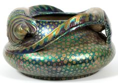 "ZSOLNAY IRIDESCENT CERAMIC PLANTER, C.1900, H 8"", W 14"":An iridescent ceramic vessel or planter, two pheasants in full relief resting atop the bulbous shoulder; a spotted ground below the pair dissolves from green to blue. Impressed underneath 'Zsolnay Pecs 6063' and painted in red 'Zsolnay Pecs Made in Hungary' Design by Lajos Mack. 17/L12,5eU"