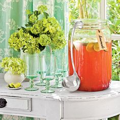 Self-serve Drink Station   serve pink lemonade from a Mason jar-inspired container with a silver ladle.   Float lime slices for extra flavor, and add a tag to let guests know what you're serving.  Lemonade jar: SL Beverage Jar with Ladle from the Southern Living Collection through Ballard Designs
