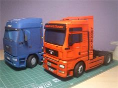This vehicle paper model is a MAN TGA 510 XXL truck, created by Papierovy, recolored by tolik32, and the scale is in 1:32.