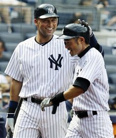 GAME 107: Sunday, Aug. 5, 2012 - New York Yankees' Derek Jeter, left, congratulates Ichiro Suzuki after Ichiro doubled in the seventh inning of their 6-2 victory over the Seattle Mariners in their baseball game at Yankee Stadium in New York.