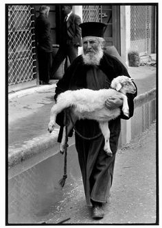 Constantine Manos 1964 GREECE. Crete. 1964. Priest in town on market day.