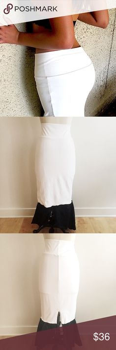 Cream White Midi Skirt with Black Ruffles! Super soft Spandex nylon poly blend stretch skirt with black satin ruffles. Measures 32 around waist, 40 from top to bottom, 39 around hips, slit 13 in long. Good condition. Slight tear where Bebe label was, beautiful egret white color. Purchased at warehouse sale, has some dust, perfect addition to wardrobe! bebe Skirts Midi