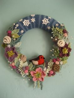 Lucy never fails to wow. Links to all the patterns for various leaves flowers and other resources in this post. Crochet Christmas wreath by Lucy of Attic 24 Crochet Christmas Wreath, Crochet Wreath, Crochet Christmas Decorations, Crochet Flowers, Christmas Wreaths, Christmas Crafts, Winter Wreaths, Christmas Christmas, Crochet Ornaments