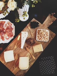 Serve cheese with several tiny wood boards so that guests can each mix and match to make their own personalized cheese plate at your party.