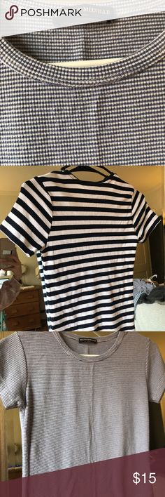 """3 Brandy Melville Tee's NWT 3 brand new Brandy Melville basic T's with stripes they are all """"one size"""" super soft & perfect for nearly any outfit; can be dressed up or down! **the picture of the model wearing the T shirt is not the exact product for sale, but same style to show what it looks like on! ** all three are originally $20 each and still have the tag attached Brandy Melville Tops Crop Tops"""