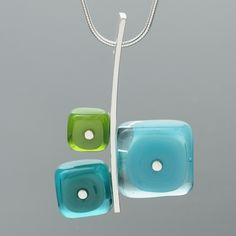 One large lampworked glass square and two smaller lampworked glass squares are mounted together to sterling silver to make a contemporary colorful necklace!