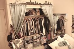Disguise a makeshift closet with shelf (curtain rod attached) and curtains