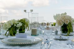 Use several smaller centerpieces, instead of one large one, to spread the cheer around the table and make it easy for guests to chat #NowSapphireRivieraCancun #Mexico #DestinationWedding