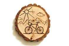 Wood burned wood slices - could be turned into coasters, magnets, table settings (for weddings) or just home decor!