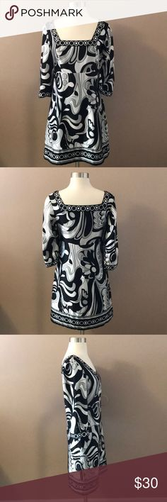 """WHBM Black/Gray Geometric Silk Tunic/Dress Black , white and gray geometric pattern on this 100% silk tunic dress . 3/4 bell sleeves and fully lined . About 32.75"""" shoulder to bottom. About 16"""" armpit to armpit. White House Black Market Dresses"""