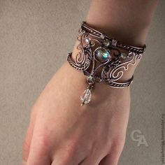"""Patinated """"Magic Dream"""" copper bracelet with a buckle that allows one to adjust the size"""