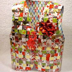 The Super Cute Wrapping Paper Vest is perfect for those looking for DIY ugly Christmas sweaters or for inexpensive holiday office party attire. Recycle your wrapping paper and look insanely awesome while doing it. Tacky Christmas Party, Paper Christmas Decorations, Christmas Mom, Christmas Gift Wrapping, Christmas Crafts, Christmas Ideas, Holiday Ideas, Boys Ugly Christmas Sweater, Boys Christmas Outfits