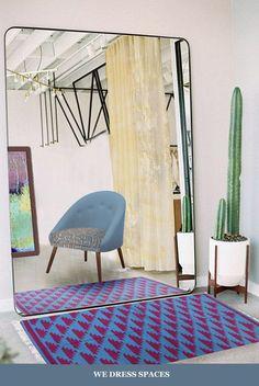 Living room – Designer studio dressed by Zeba.  Accent – Colour – Look – ZEBA  #Dhurrie #chairupholstery #curtain #wallart #co-ordinatedlook #studio