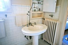 Pittock Mansion 1914: Guest Bathroom Sink. A small bathroom upstairs, with a shower head-like faucet.